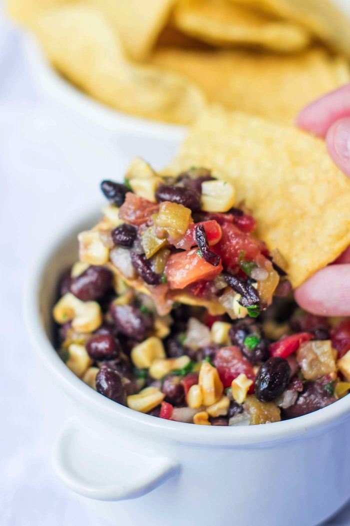 Served as an appetizer with chips or as a fresh summer salad, everyone loves 3 Pepper Black Bean and Corn Salsa! Full of black beans, corn and peppers!