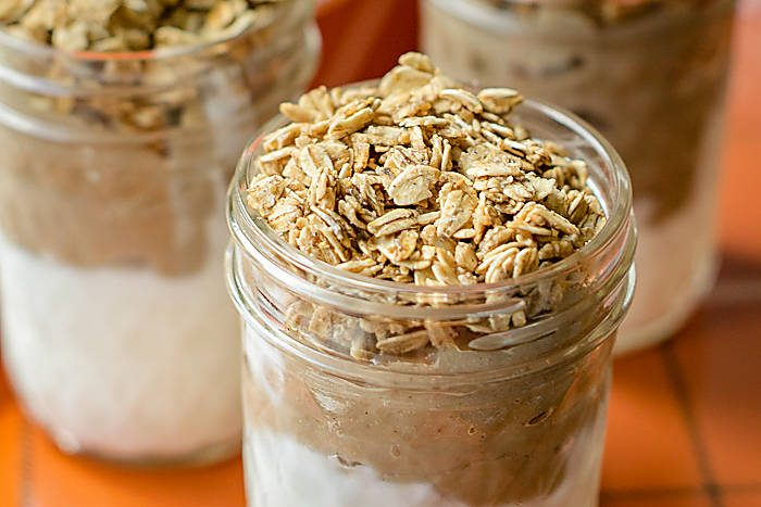 Pumpkin spice yogurt and granola parfaits will fill all your fall cravings! Simply layer Greek yogurt and granola with an easy to prepare pumpkin pudding.