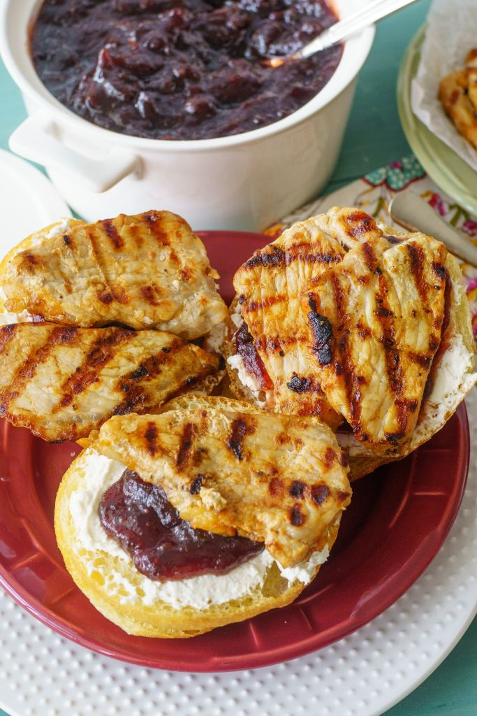 A spicy jalapeño cranberry jelly tops these grilled pork tenderloin sandwiches to make a fast and tasty weeknight meal in under 30 minutes!