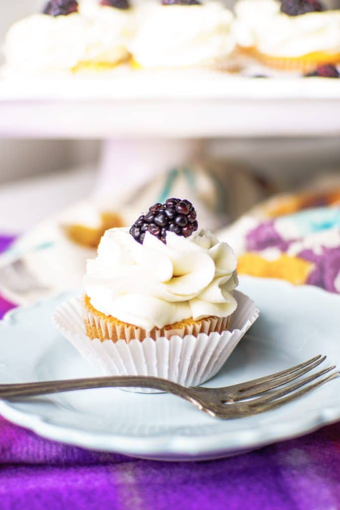 Prosecco Cupcakes with Blackberry Compote will wow your taste buds! Prosecco makes this delectable cupcake sophisticated enough for any dinner party.