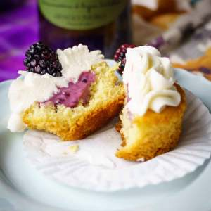 vanilla prosecco cupcakes with prosecco icing and a blackberry filling