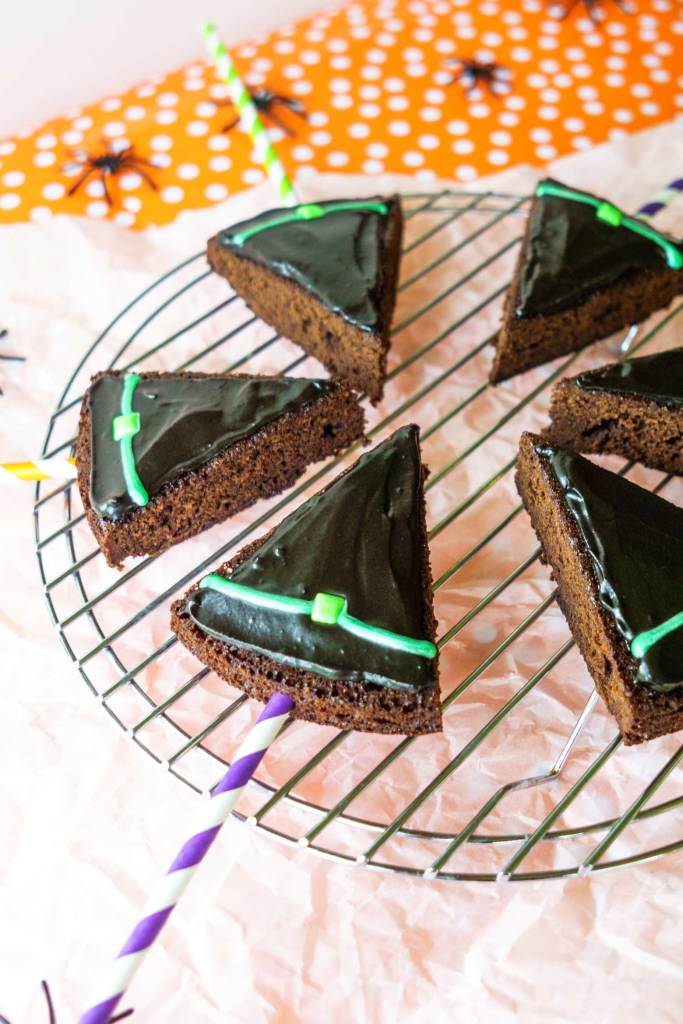Witch hat cake pops use a box brownie mix, fast frosting, and an easy piping method!