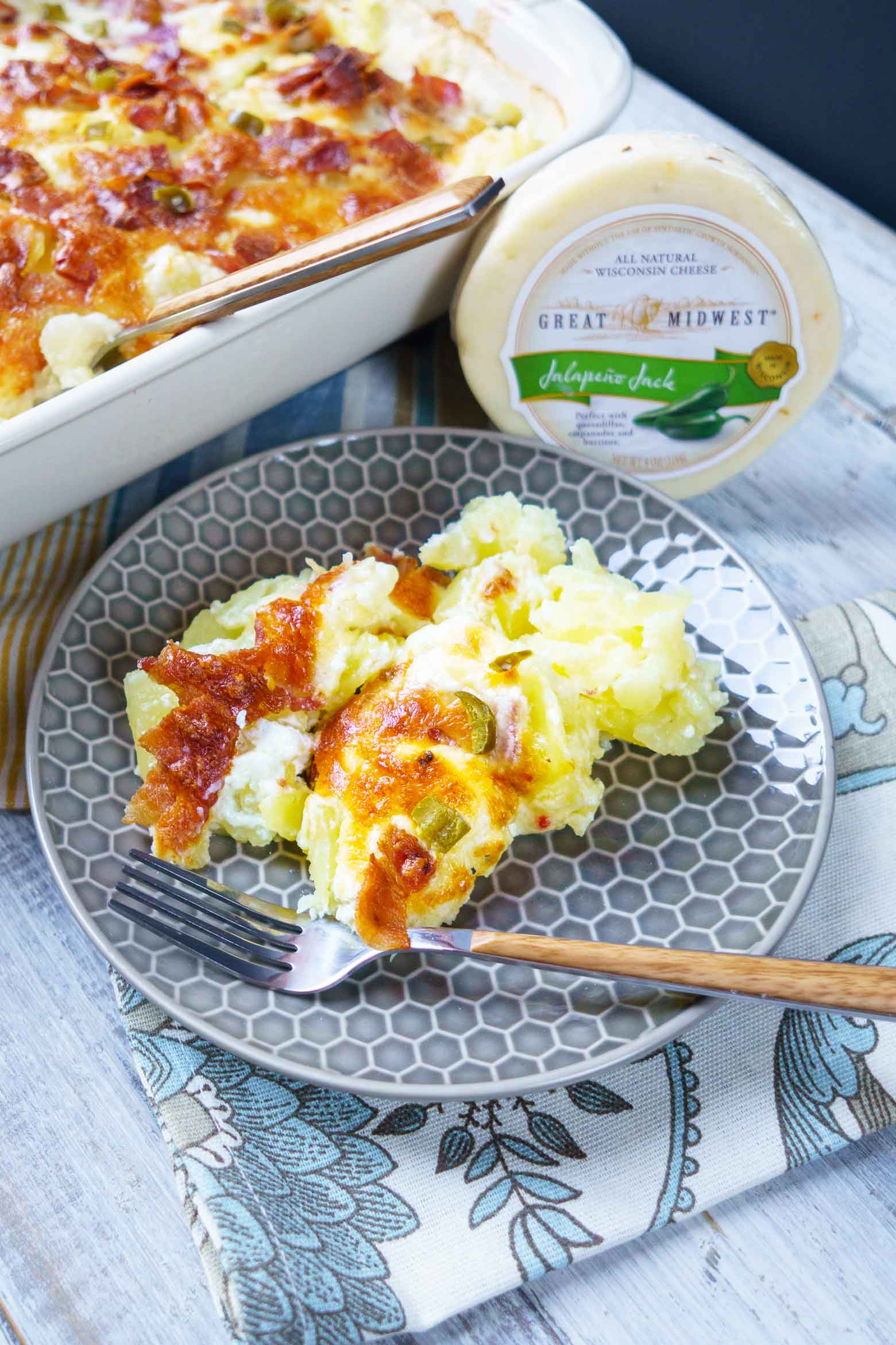Scallop potatoes with bacon and cheesy cream sauce