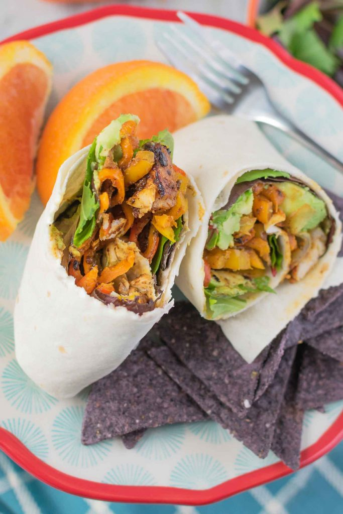 chicken avocado wrap with grilled chicken, peppers, avocado, lettuce and more in a tortilla shell