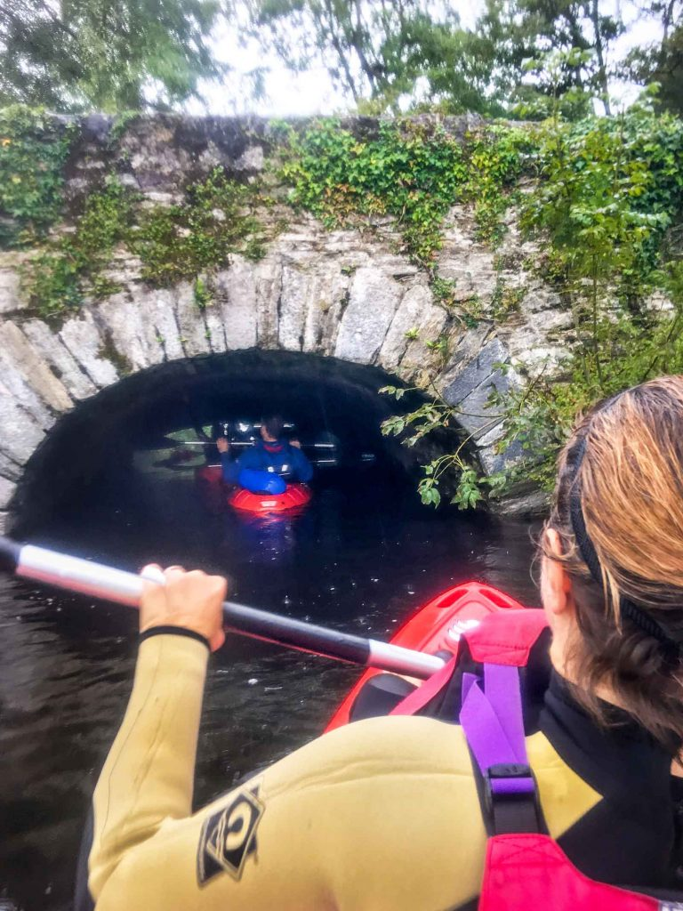 kayaking under the bridge by Ross castle