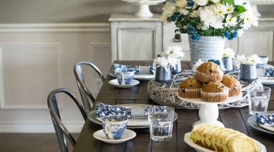 This blue and white china spring tablescape is sure to wow your guests on Easter and beyond. It utilizes antique blue and white antique ironstone as well as modern napkins and a fresh floral centerpiece.