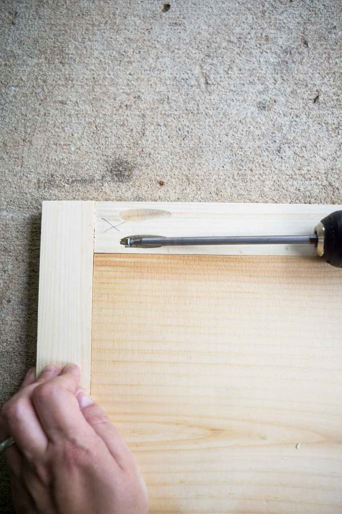 Using a drill to make a DIY frame