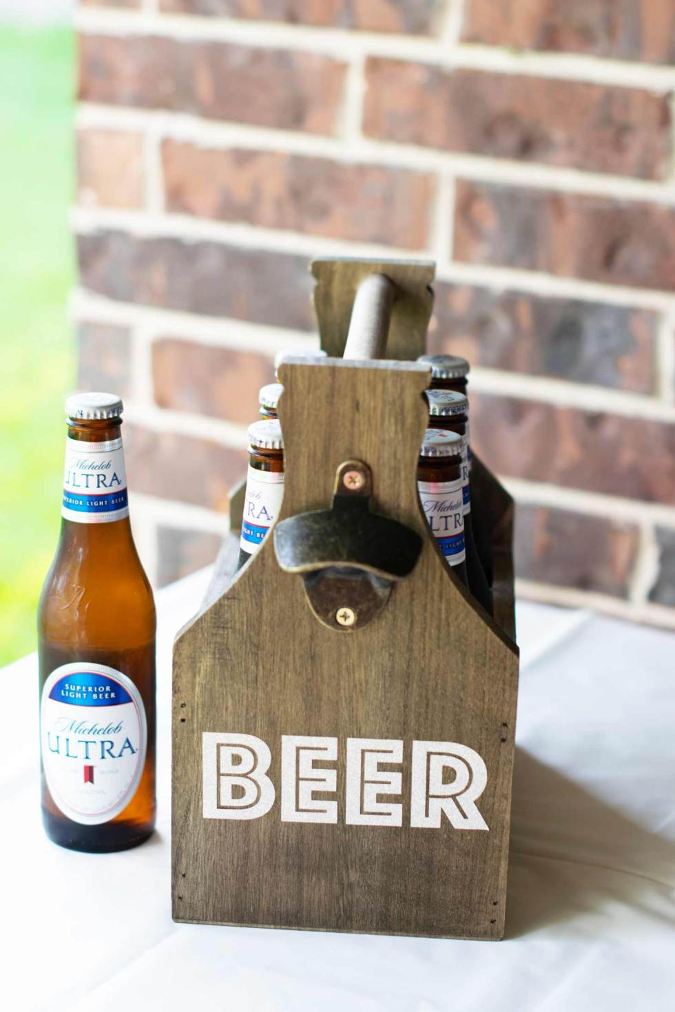 wooden beer holder customized with the word BEER via free SVG.