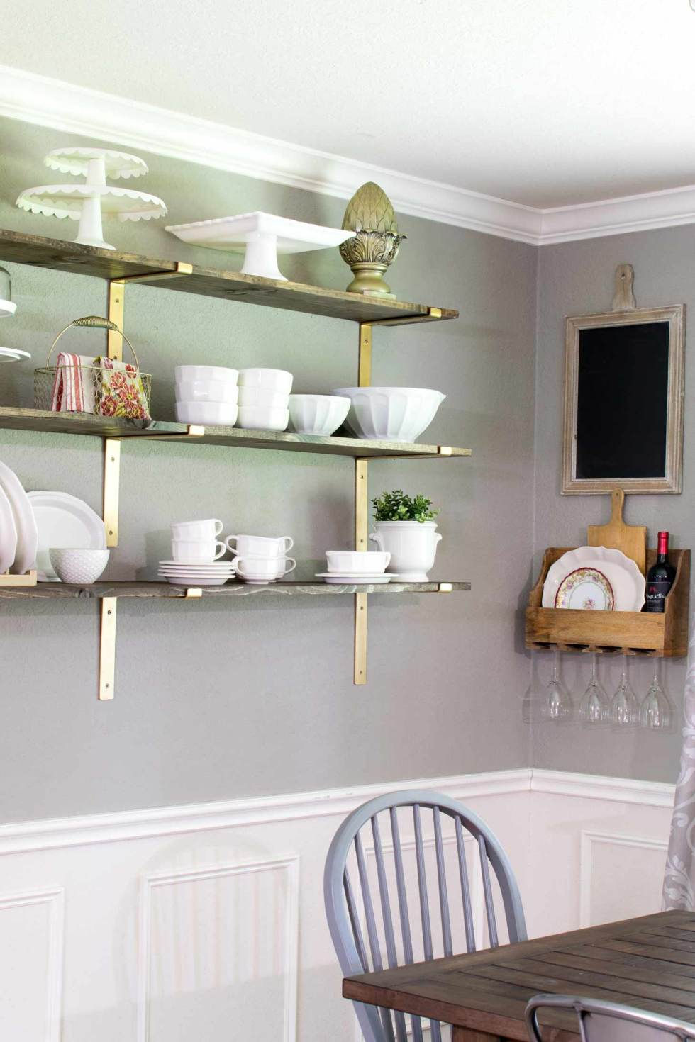 Gold brackets with rustic shelves for a luxury farmhouse feel