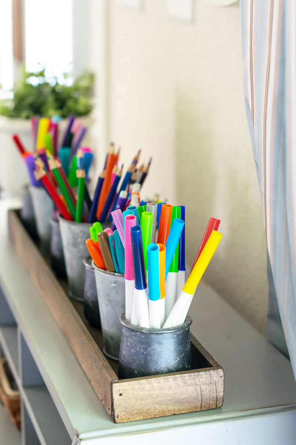 a desktop organizer tray holds markers pencils crayons and more