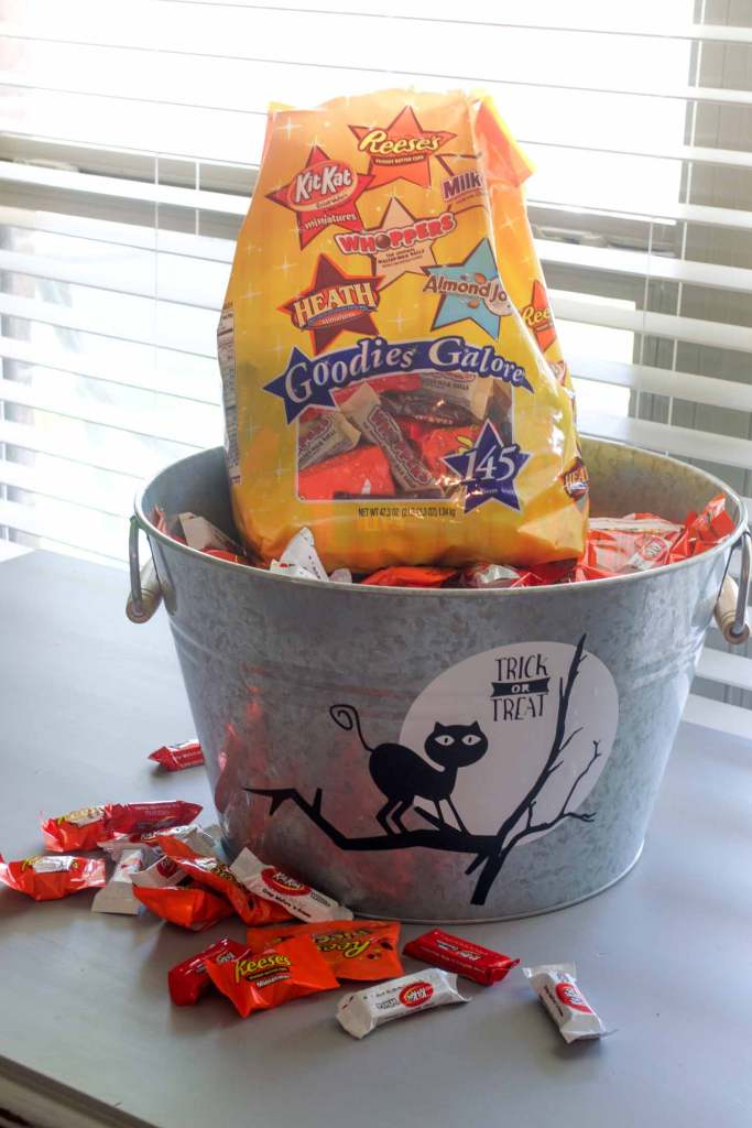 Place all your favorite mini candy bars in this decorated galvanized bucket for halloween