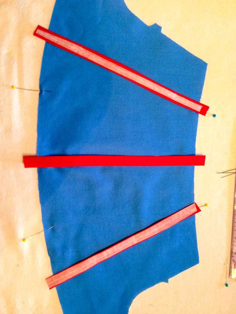iron on fusible on bias tape for sewing a DIY Snow White dress sleeve