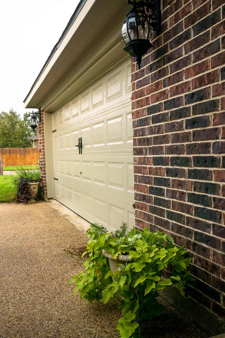 side view of a newly painted garage door with faux metal handles and hinges