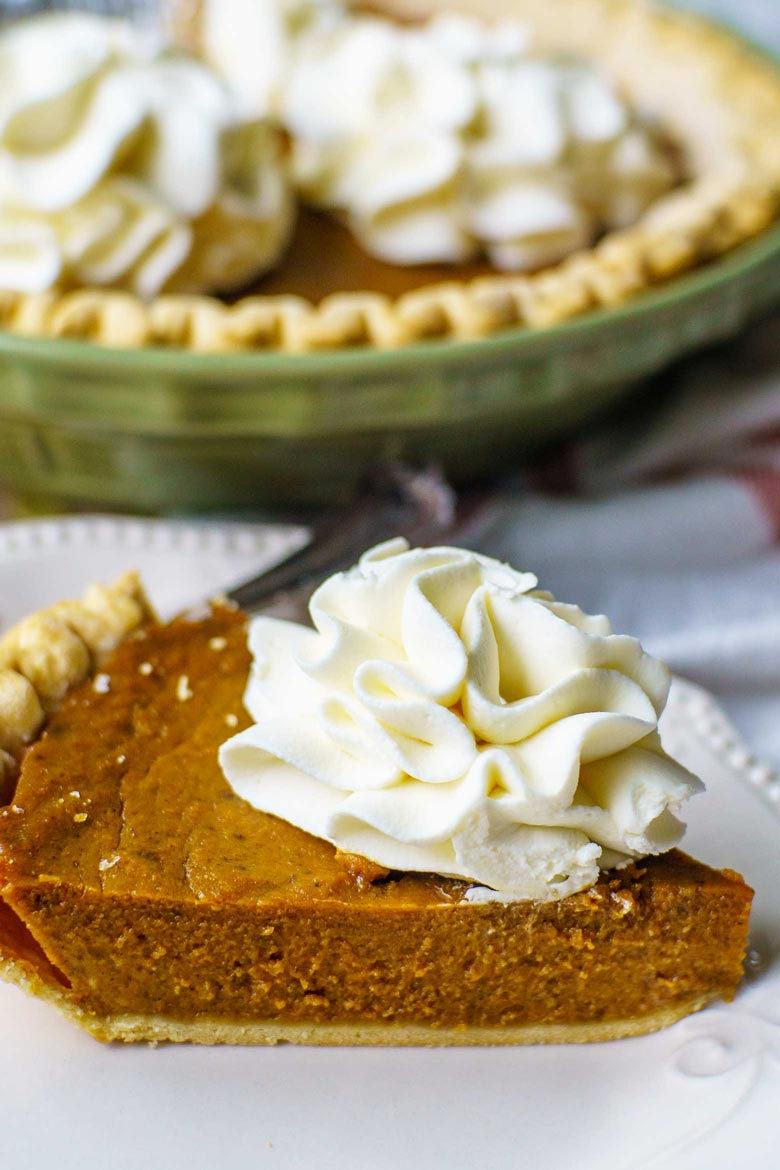 This pumpkin pie recipe uses molasses and is topped with homemade whipped cream frosting