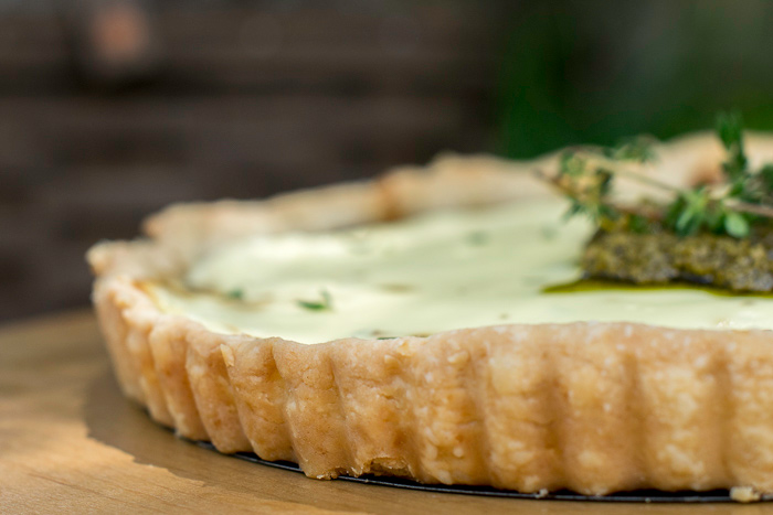 A basic tart crust is all that is needed for this savory onion tart featuring goat cheese