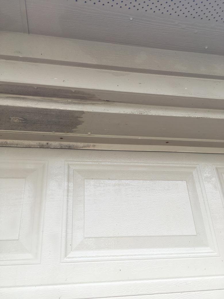 using an outdoor cleaner to clean your garage door