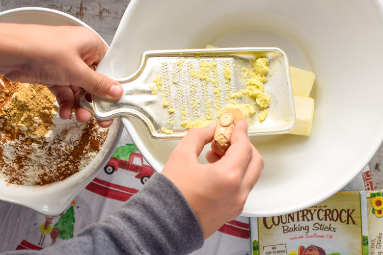 grating fresh ginger for gingerbread reindeer cookies
