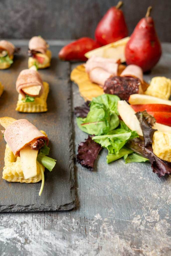 simple goat cheese appetizers are made with meat, fruit topping puff pastries