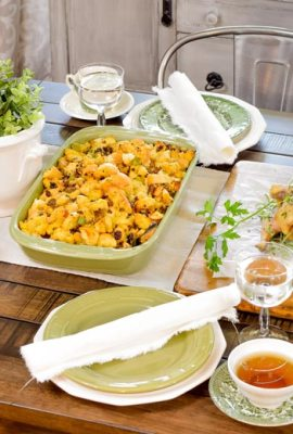 holiday favorite side dishes including sausage stuffing, cranberry sauce and more to go alongside a Thanksgiving table setting
