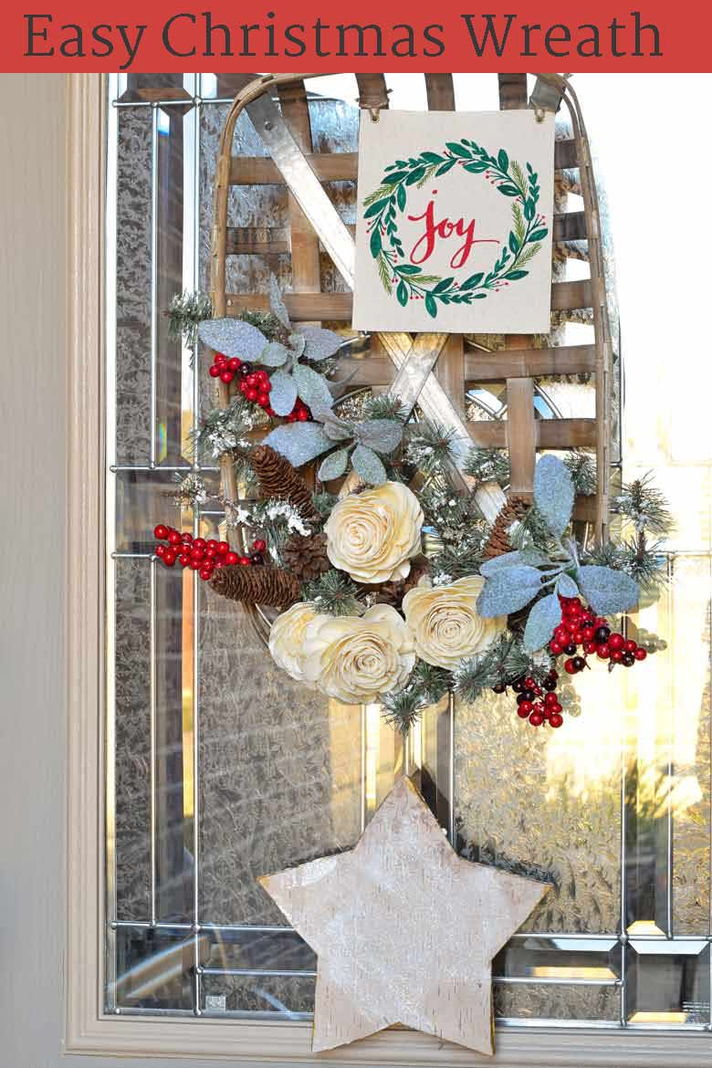 A winter wreath on your front door is a cozy welcome to all your guests. This tutorial will show you how to make a basket wreath for Christmas and beyond! See the step by step process on how to assemble this inexpensive wreath, how to make it perfect for the holiday season, and how to modify it to be used all winter long! #Christmas #wreath #winter #christmasdecor via @mrsmajorhoff