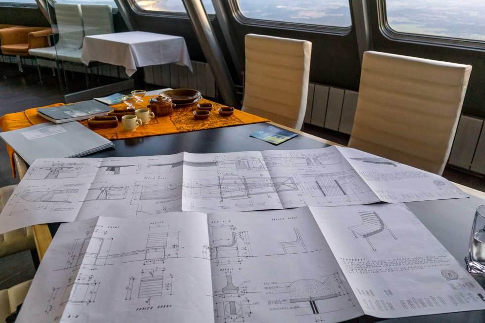 blueprints next to modern chair from Czech Republic