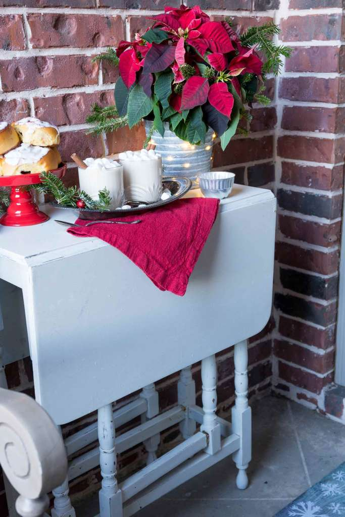 white gate leg table with drinks and dessert on top for Christmas