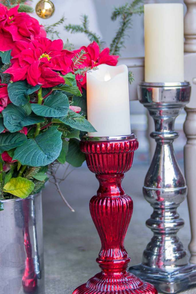 Poinsettia in a mercury glass vase with mercury candlesticks