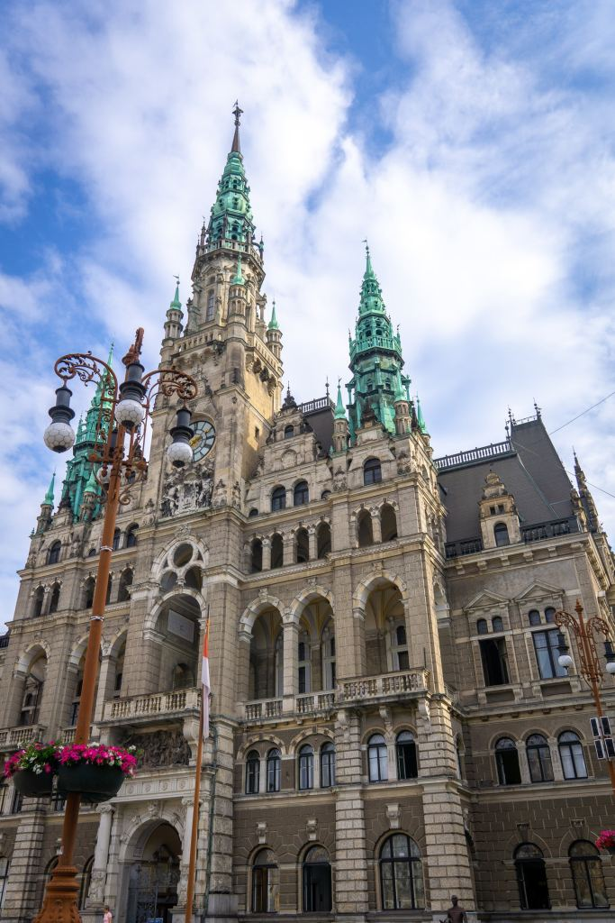 Front of the Liberec town hall with blue green patina on the top towers