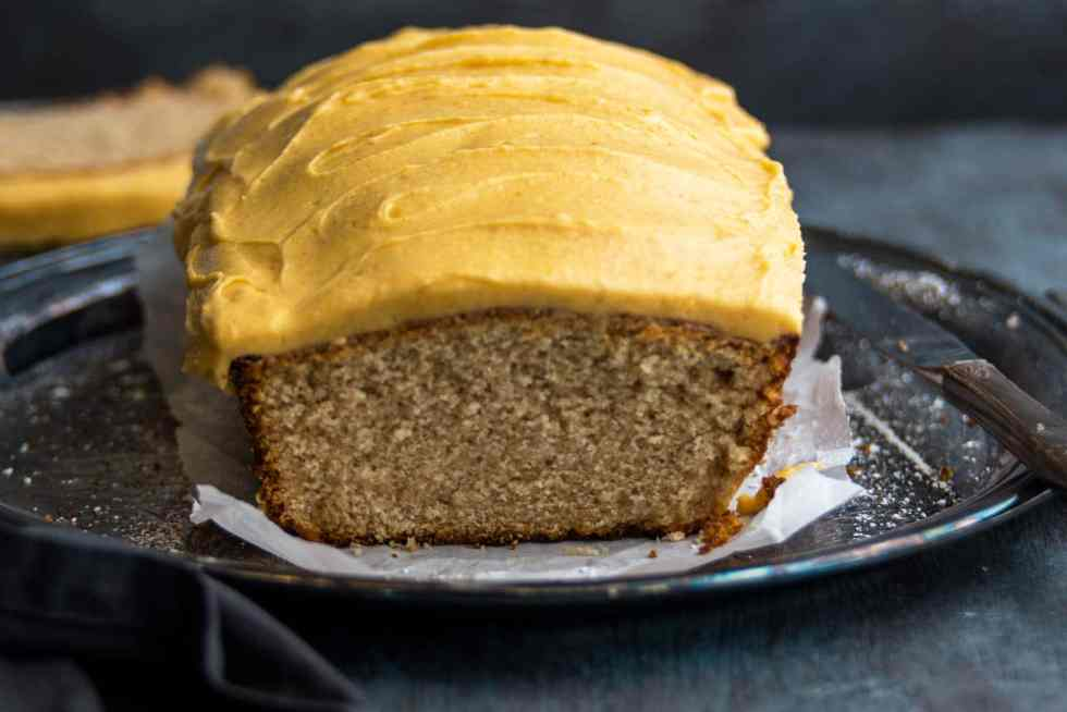 Pumpkin frosting iced autumn loaf cake on silver tray