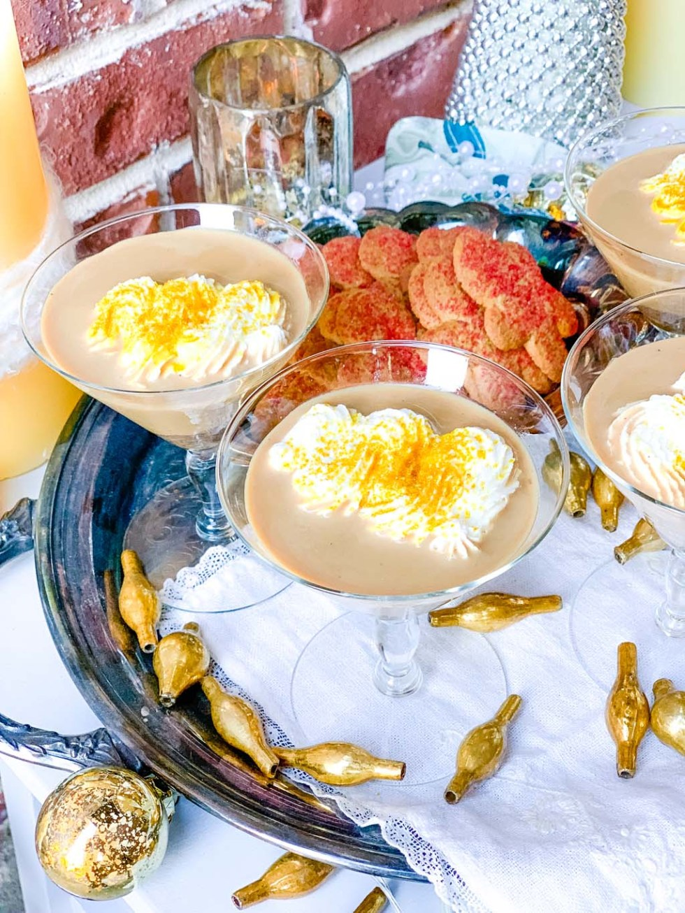 gingerbread cocktails on a silver tray with gold accents