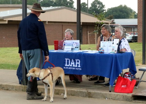 DAR chapter members at table handing out bookmarks.
