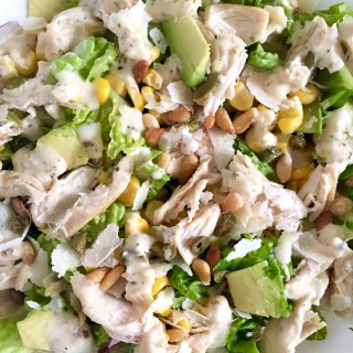 Chicken Caesar Salad with Corn, Avocado, and Pine Nuts