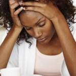 stressed black woman land fraud scam