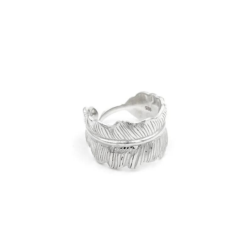 anillo pluma de plata ajustable