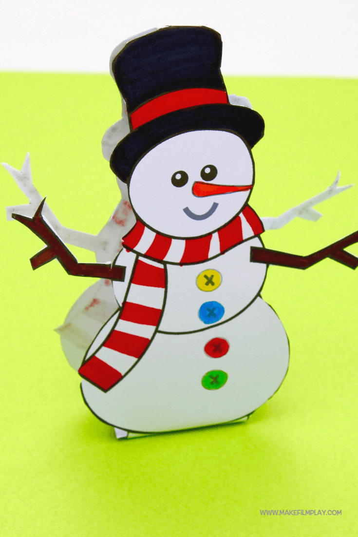 Print out and colour this cute paper Snowman. Add glue to the bottom fold to make him stand by himself. He makes an excellent paper puppet or a fantastic Christmas decoration! #kidscrafts #christmas #printable #snowman #christmascrafts