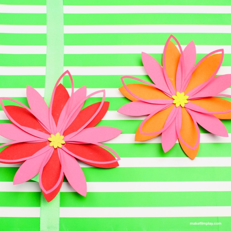 Make these pretty paper flowers with the free printable template that can be used in Cricut Design Space or cut out by hand. These flowers are the perfect size for a gift topper or pretty as home decor. #papercrafts #paperflower #designspace #gifttopper, #flowertemplate #paperflowers #flower #crafts