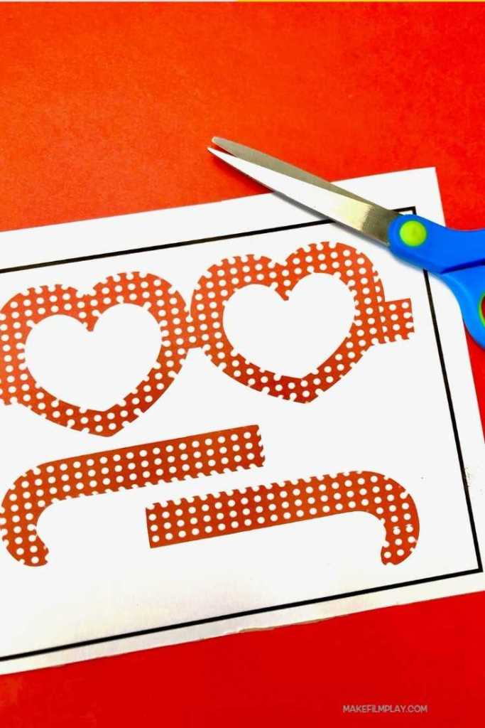 Celebrate Valentine's Day in style with these cute heart-shaped paper glasses. #valentinesday #paperglasses #crafts #kidscrafts #printable #cricut