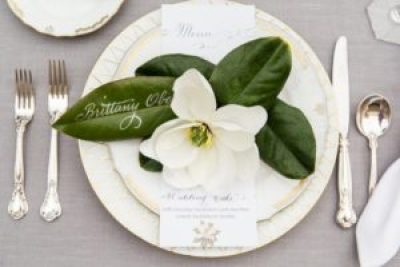 Place setting with magnolia flower