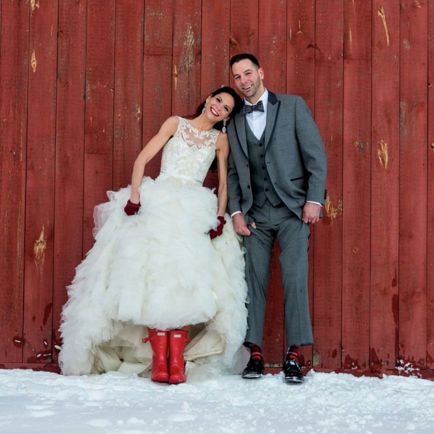 winter wedding couple, bride wearing red boots