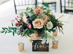 wedding planner completes floral arrangement
