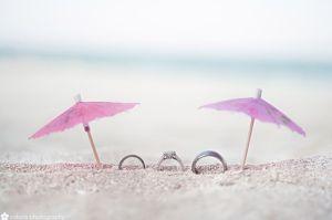 rings on the beach during honeymoon