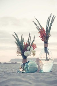 florals in vase on beach