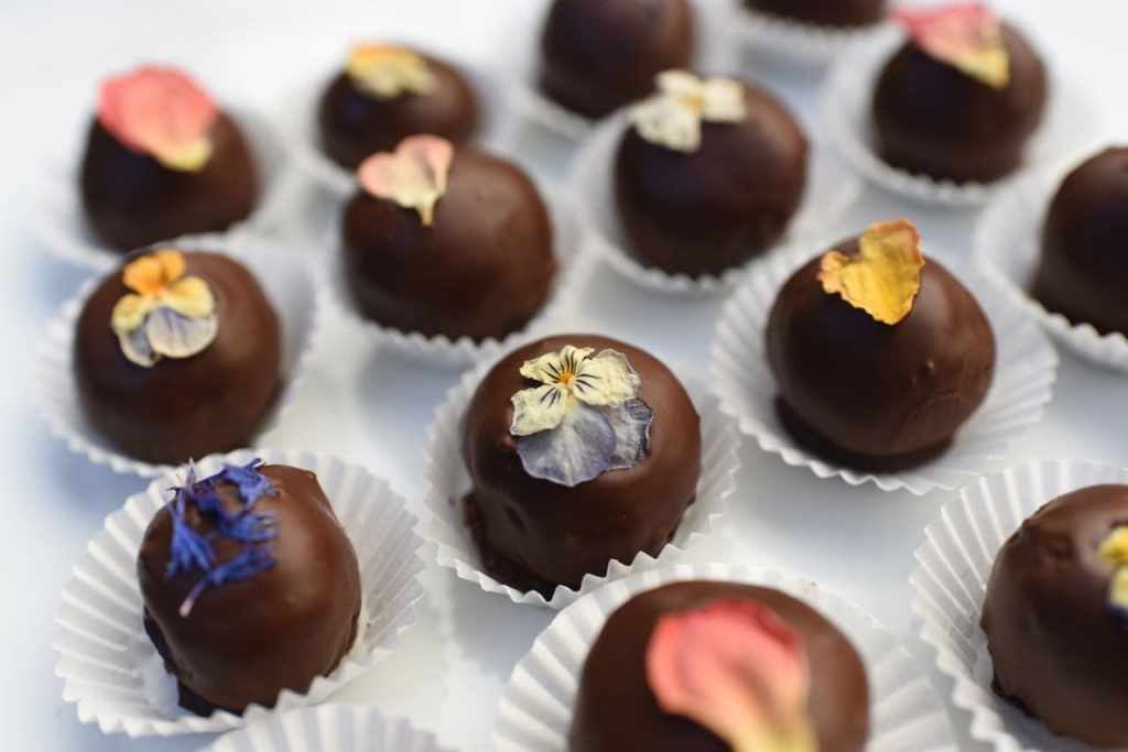 Chocolate truffles topped with edible flowers