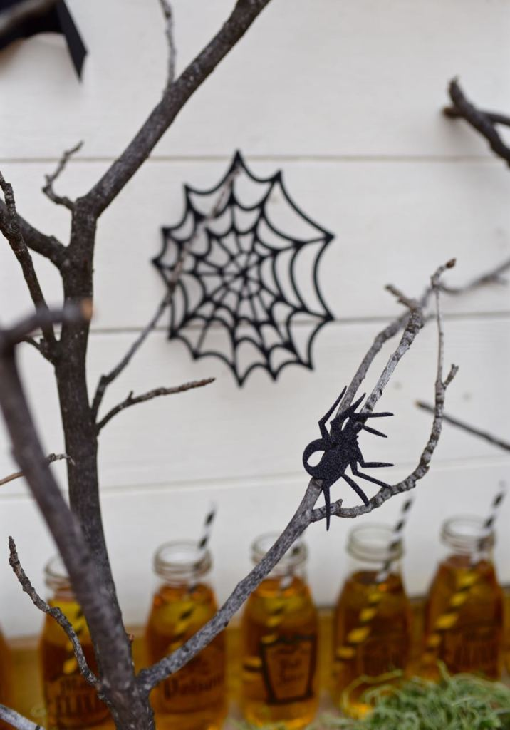 Spider webs and trees backdrop at a haunted forest Halloween party