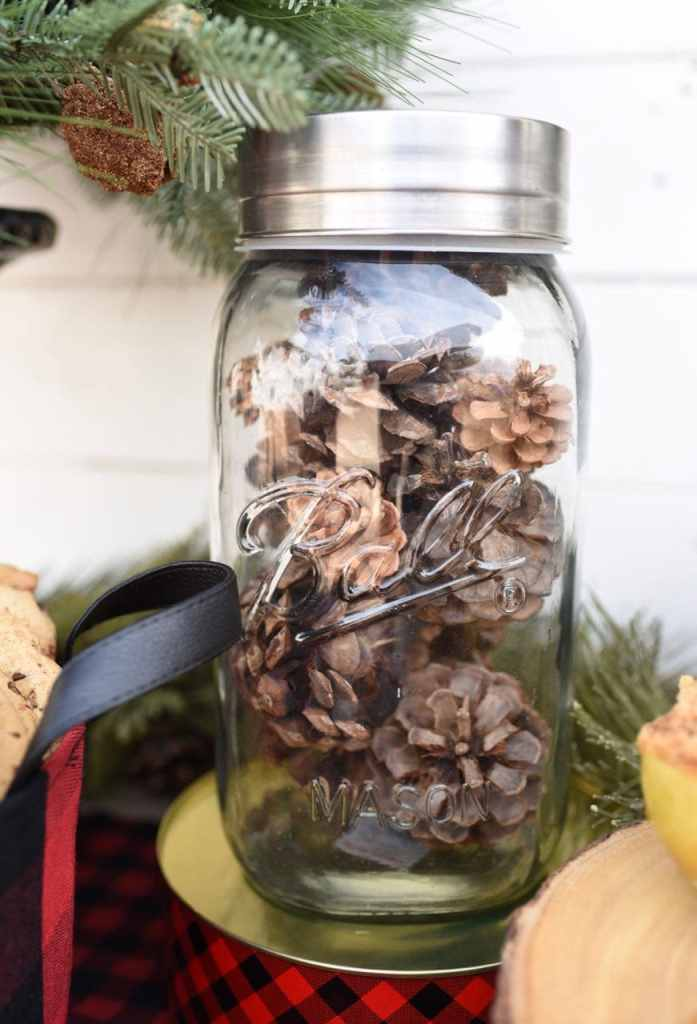 Pinecones in a mason jar at a rustic holiday party