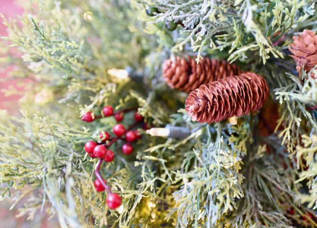 Christmas greenery with berries and pinecones