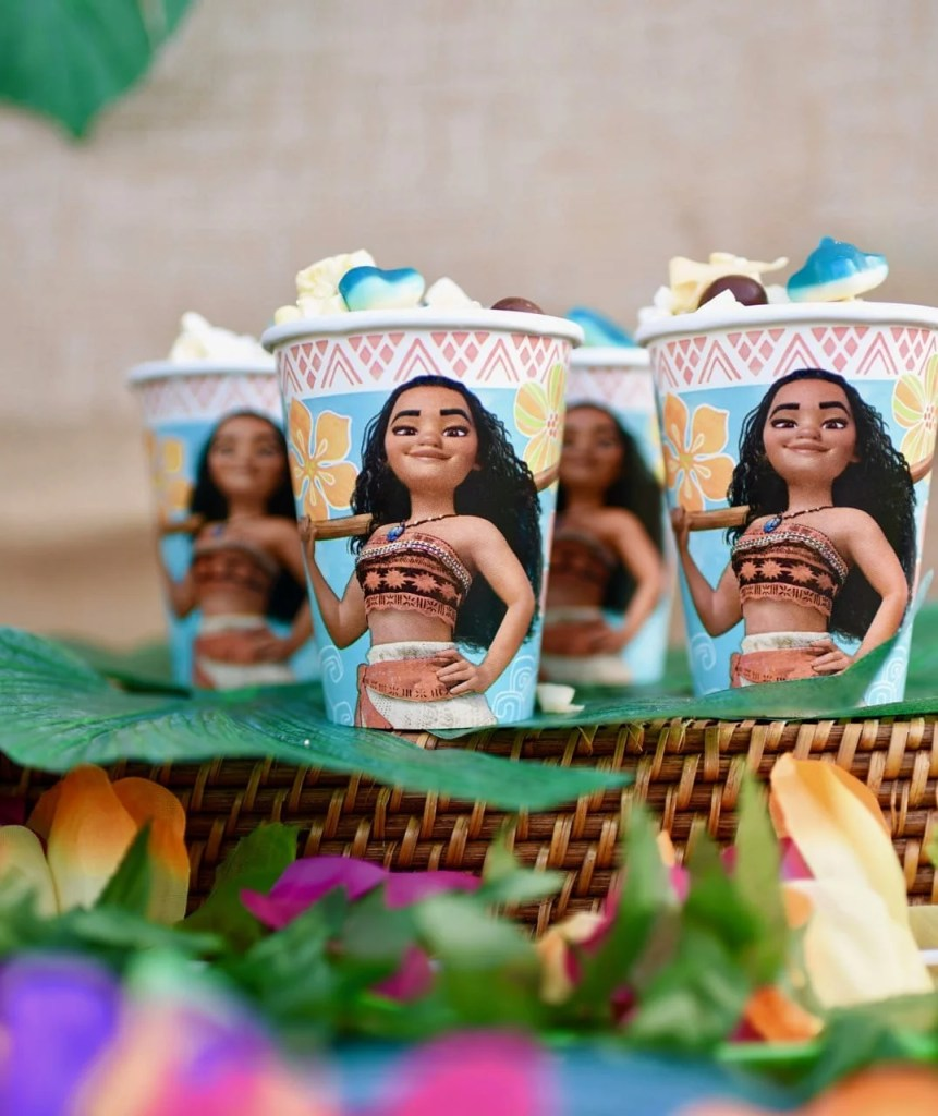 Serve Moana snack mix in paper cups for a Moana party.