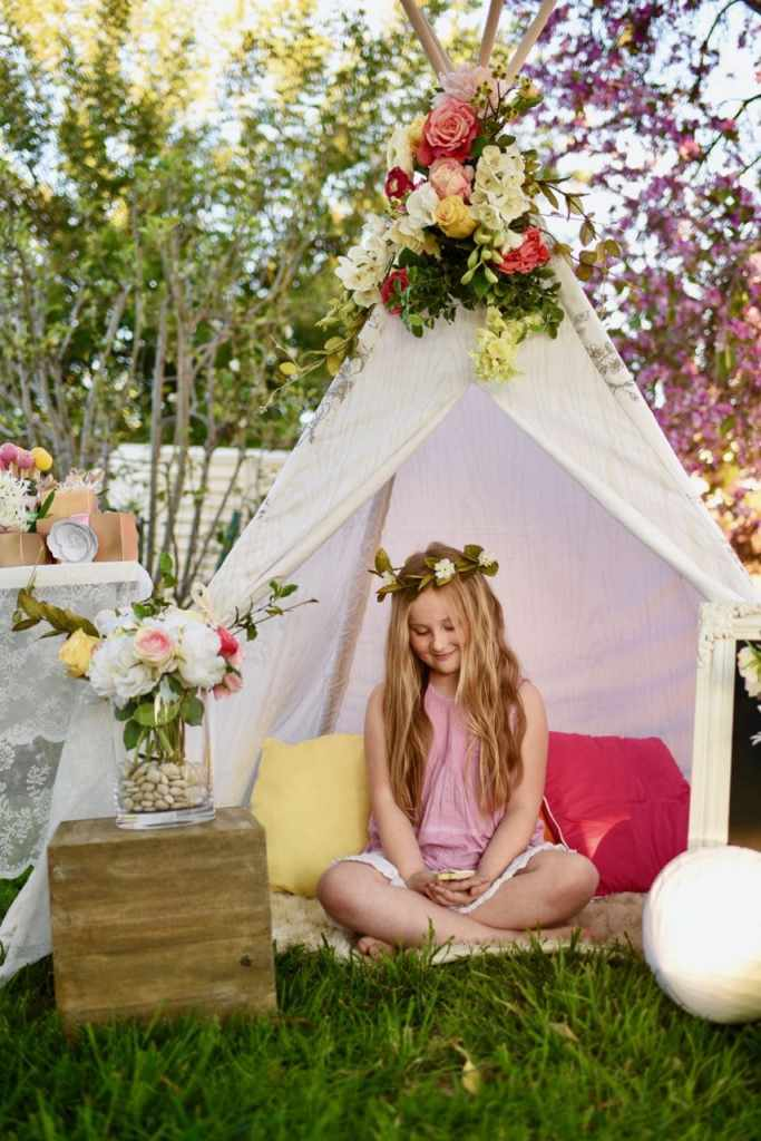 Amazing Girls boho party with teepee, flowers, and woodland details.