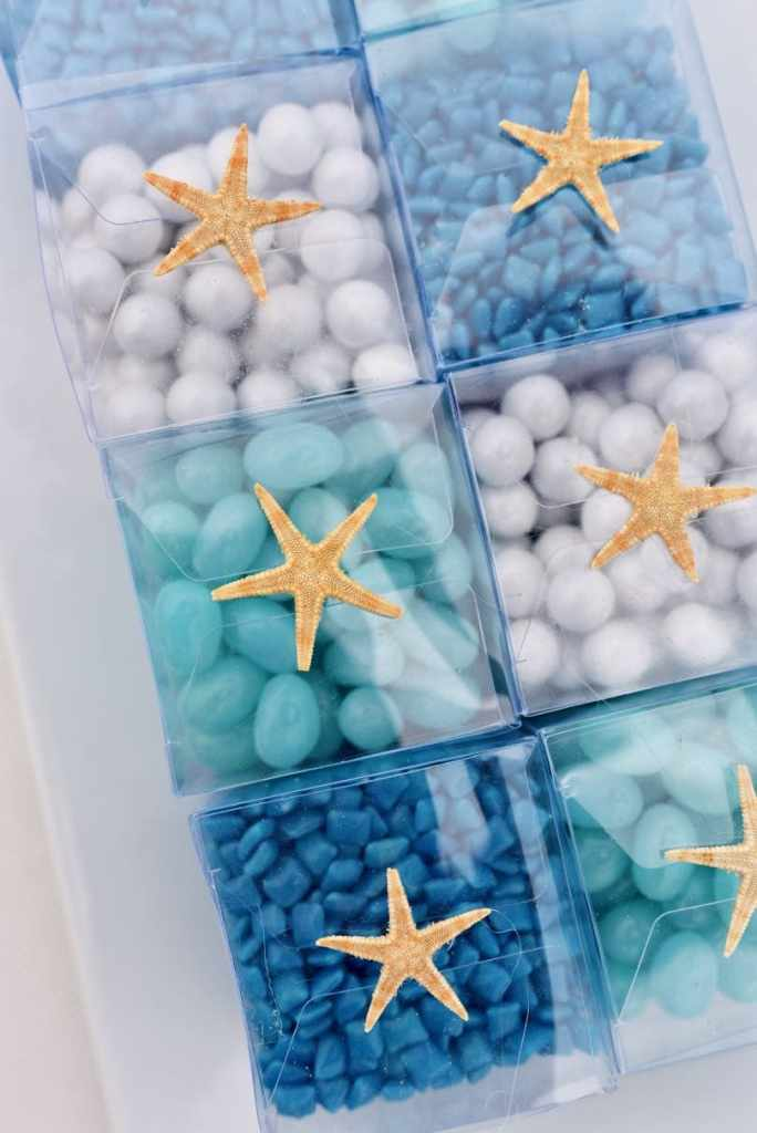 Blue ocean themed wedding party favors at candy buffet