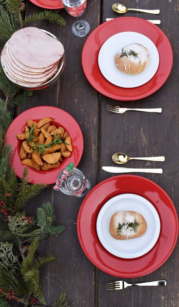 Holiday dinner party on long rustic farmhouse table